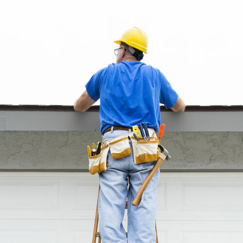 A Roofer Inspects a Roof.