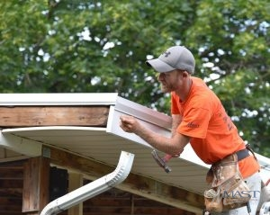 Roofer Completing Home Repair Services
