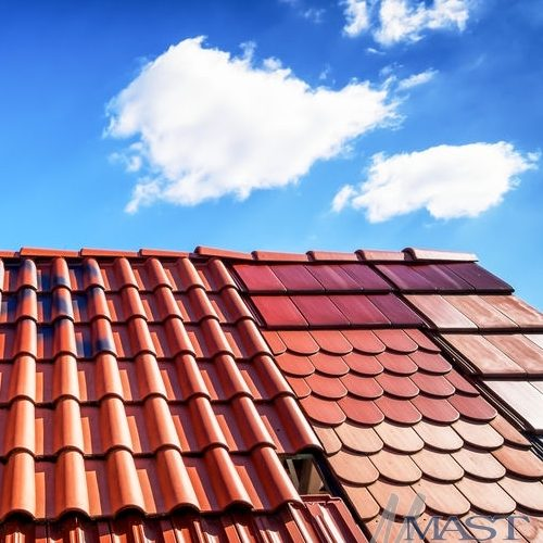 Different metal roof tiles on a residential home.