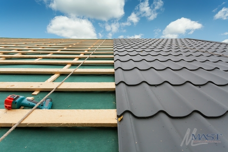 Grey Metal Roof, Made to Look Like Tile, in the Process of Installation.