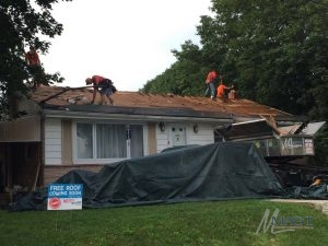 Residential Roofing Contractors Repairing a Roof