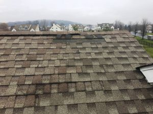 Shingle Roof Needing Roof Wind Damage Repair